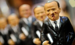 Silvio Berlusconi models with blood on their faces on sale in Naples. Photograph: Roberto Salomone/AFP/Getty Images